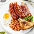 Full English breakfast with bacon, sausage, fried egg and baked  — Zdjęcie stockowe #54164803