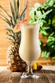 Pina Colada on wooden background garnished pineapple — Stock Photo