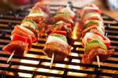Grilling shashlik on barbecue grill — Foto Stock