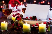 Christmas card in dishware — Stock Photo
