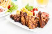 Chicken wings with fries french and spicy sauce — Stockfoto