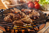 Grilling chicken wings on barbecue grill — Foto Stock