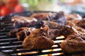 Grilling chicken wings on barbecue grill — Stockfoto