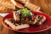 Waffles with chocolate sauce, whipped cream and confiture — Stok fotoğraf
