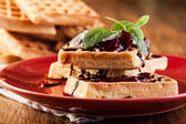 Waffles with chocolate sauce, whipped cream and confiture — Stock Photo