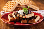 Waffles with chocolate sauce, whipped cream and confiture — Stock fotografie