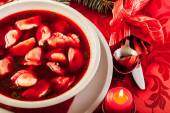 Christmas red borscht with meat filled dumplings — Stock Photo