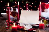 Christmas card in dishware at the table — Stock Photo