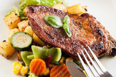 Fried pork with potatoes and vegetables salad — Stock Photo