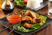 Fried chicken pieces in batter — Stock Photo