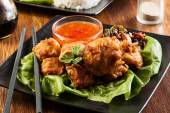 Fried chicken pieces in batter — Photo