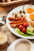 English breakfast with sausage — Stock Photo