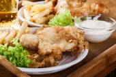 Fish and chips with tartar sauce on a tray — Stock Photo