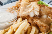 Fish and chips with tartar sauce on a plate — Stock Photo