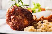 Pork knuckle with fried sauerkraut — Stock Photo