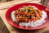 Chinese chicken with rice noodles — Stock Photo