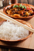 Bowl of rice noodles on table — Stock Photo