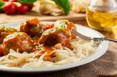 Pasta fettuccine and meatballs with tomato sauce — Photo
