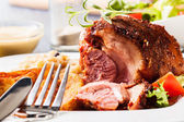 Pork knuckle with fried sauerkraut — Stock Photo