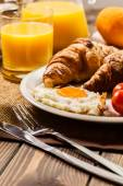 Breakfast with croissant end orange juice — Stock Photo
