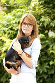 Veterinarian carrying king charles cavalier — Stock Photo