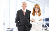 Successful business woman and businessman — Stock Photo