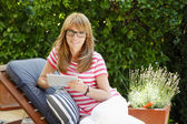 Mature woman in garden — Stock Photo