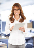 Middle age businesswoman with digital tablet — Stock Photo