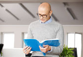 Businessman reading presentation — Stock Photo