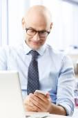 Businessman using mobile phone — Stock Photo