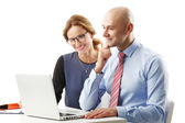 Businesswoman and businessman working at laptop — Stock Photo