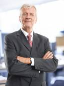 Senior lawyer standing at office — Stock Photo