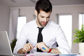 Young businessman with laptop — Stock Photo