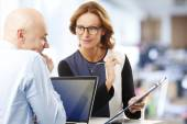 Sales man consulting with businesswoman — Stock Photo