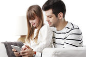 Girl with dad looking at tablet — Stockfoto