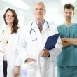 Male professor and medical team — Stock Photo #61841629