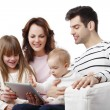 Family with tablet on sofa — Stock Photo #61841797