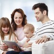 Family with tablet on sofa — Stock Photo #61841899