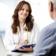 Female doctor consulting with patient — Stock Photo #61842511
