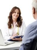 Female doctor consulting with patient — Stock Photo