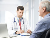 Male doctor with old patient — Stock Photo