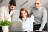 Businesswoman and her colleagues analyzing data — Stock Photo