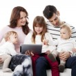 Young family using digital tablet — Stock Photo #65349259