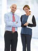 Businesswoman and businessman at office — Stock Photo