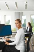 Businesswoman sitting at office — Stock Photo
