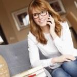 Designer woman making a call — Stock Photo #67579209