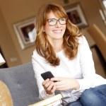 Designer woman using mobile phone — Stock Photo #67579213