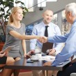 Businesswoman and businessman shaking hands — Stock Photo #67824601