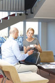 Businessman interviewing businesswoman at office — Stock Photo
