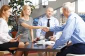Businesswoman and businessman shaking hands — Stock Photo